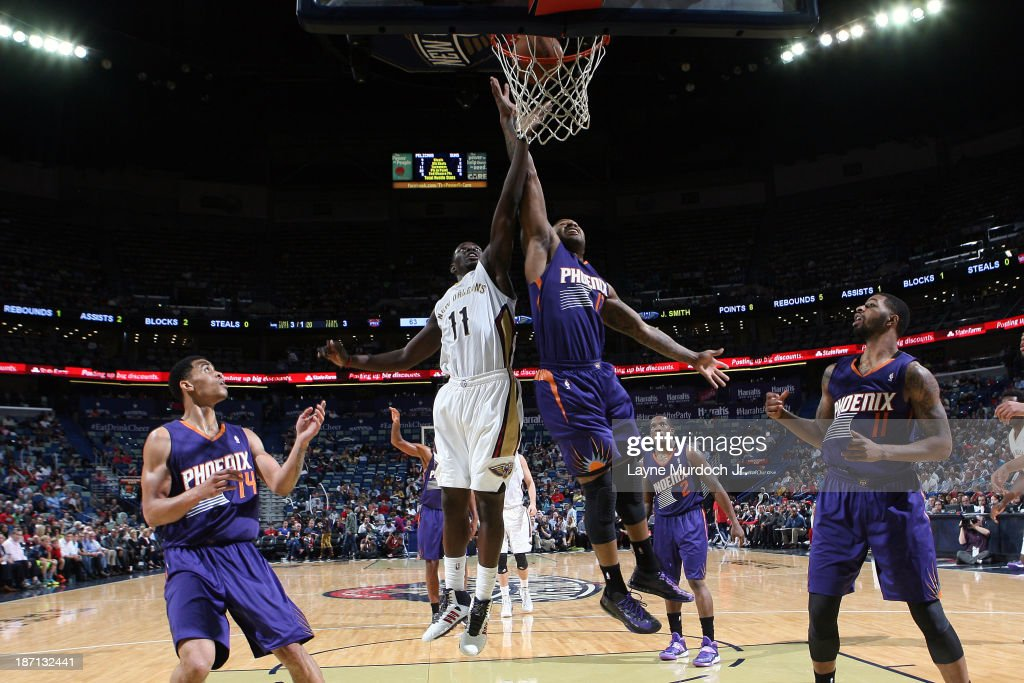 <a gi-track='captionPersonalityLinkClicked' href=/galleries/search?phrase=Jrue+Holiday&family=editorial&specificpeople=5042484 ng-click='$event.stopPropagation()'>Jrue Holiday</a> #11 of the New Orleans Pelicans and <a gi-track='captionPersonalityLinkClicked' href=/galleries/search?phrase=P.J.+Tucker&family=editorial&specificpeople=227316 ng-click='$event.stopPropagation()'>P.J. Tucker</a> #17 of the Phoenix Suns go up for a rebound on November 5, 2013 at the New Orleans Arena in New Orleans, Louisiana.