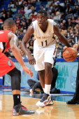 Jrue Holiday of the New Orleans Pelicans controls the ball against the Portland Trail Blazers on December 30 2013 at the New Orleans Arena in New...