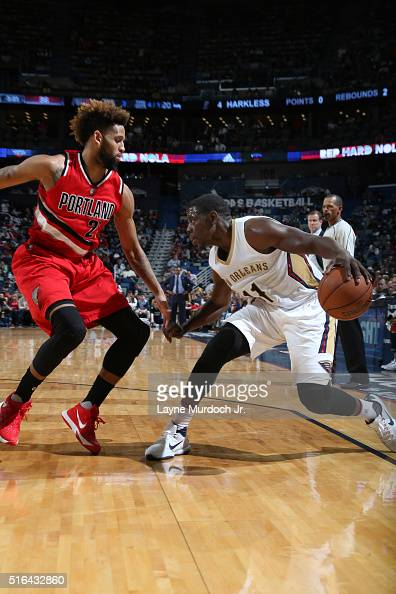Jrue Holiday of the New Orleans Pelicans defends the ball against Allen Crabbe of the Portland Trail Blazers during the game on March 18 2016 at...
