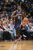 Jrue Holiday of the New Orleans Pelicans dribbles down the court against the Memphis Grizzlies during the game on November 3 2014 at FedExForum in...