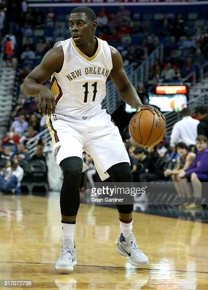 Jrue Holiday of the New Orleans Pelicans dribbles down the court against the Miami Heat during the first half at Smoothie King Center on March 22...
