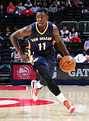 Jrue Holiday of the New Orleans Pelicans dribbles the ball during the game against the Atlanta Hawks on October 6 2014 at Philips Arena in Atlanta...