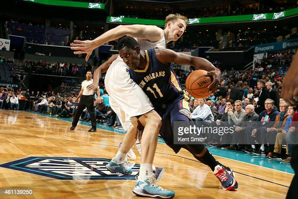 Jrue Holiday of the New Orleans Pelicans drives against Cody Zeller of the Charlotte Hornets during the game at the Time Warner Cable Arena on...