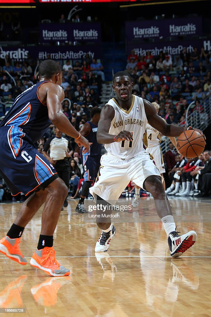<a gi-track='captionPersonalityLinkClicked' href=/galleries/search?phrase=Jrue+Holiday&family=editorial&specificpeople=5042484 ng-click='$event.stopPropagation()'>Jrue Holiday</a> #11 of the New Orleans Pelicans drives against <a gi-track='captionPersonalityLinkClicked' href=/galleries/search?phrase=Ramon+Sessions&family=editorial&specificpeople=805440 ng-click='$event.stopPropagation()'>Ramon Sessions</a> #7 of the Charlotte Bobcats on November 2, 2013 at the New Orleans Arena in New Orleans, Louisiana.