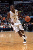 Jrue Holiday of the New Orleans Pelicans drives against the Denver Nuggets on December 27 2013 at the New Orleans Arena in New Orleans Louisiana NOTE...
