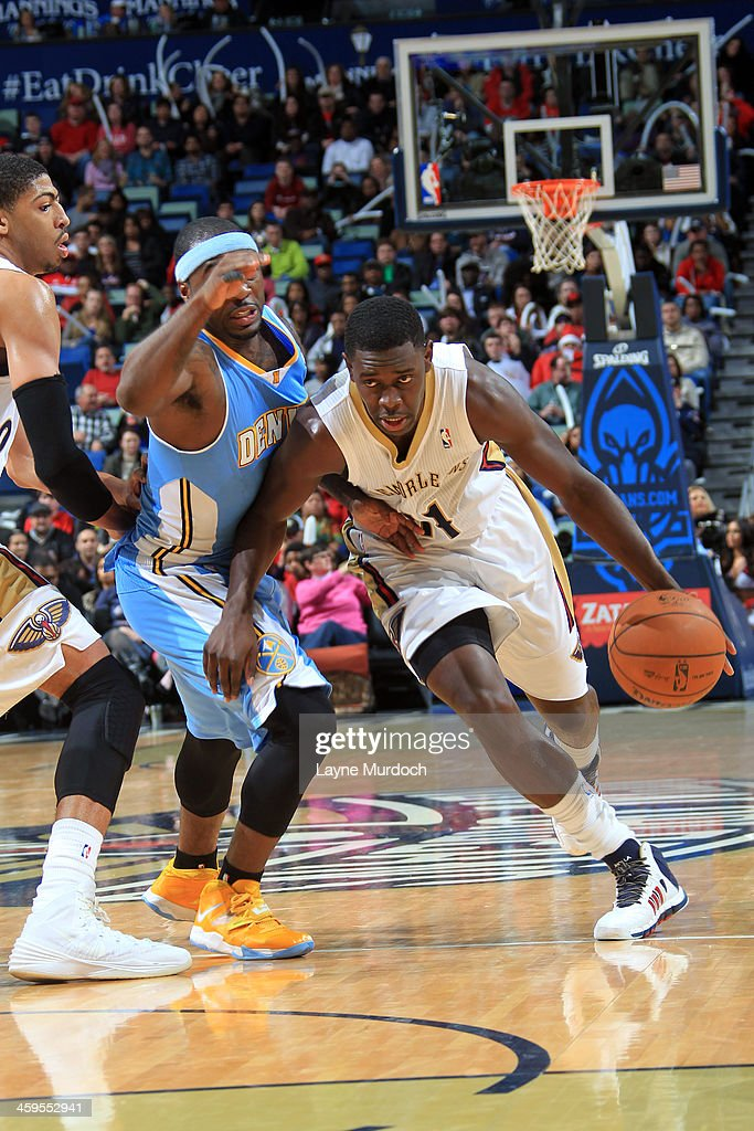 <a gi-track='captionPersonalityLinkClicked' href=/galleries/search?phrase=Jrue+Holiday&family=editorial&specificpeople=5042484 ng-click='$event.stopPropagation()'>Jrue Holiday</a> #11 of the New Orleans Pelicans drives against the Denver Nuggets on December 27, 2013 at the New Orleans Arena in New Orleans, Louisiana.