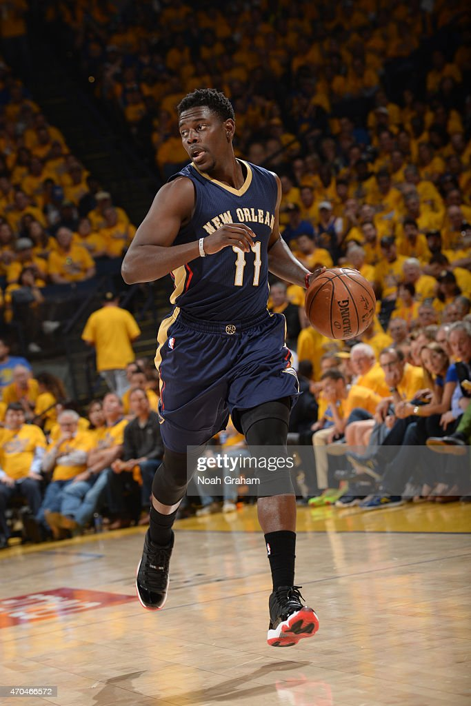 Jrue Holiday of the New Orleans Pelicans drives against the Golden State Warriors in Game One of the Western Conference Quarterfinals during the NBA...