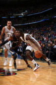 Jrue Holiday of the New Orleans Pelicans drives against the Memphis Grizzlies on December 13 2013 at New Orleans Arena in New Orleans Louisiana NOTE...