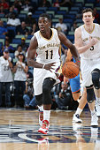 Jrue Holiday of the New Orleans Pelicans drives against the Oklahoma City Thunder during an NBA game on October 16 2014 at the Smoothie King Center...