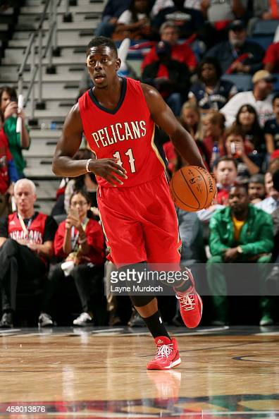 Jrue Holiday of the New Orleans Pelicans drives against the Orlando Magic on October 28 2014 at Smoothie King Center in New Orleans LA NOTE TO USER...
