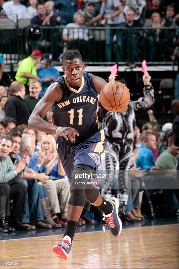 <a gi-track='captionPersonalityLinkClicked' href=/galleries/search?phrase=Jrue+Holiday&family=editorial&specificpeople=5042484 ng-click='$event.stopPropagation()'>Jrue Holiday</a> #11 of the New Orleans Pelicans drives down the court against the Dallas Mavericks December 10, 2014 at the American Airlines Center in Dallas, Texas.