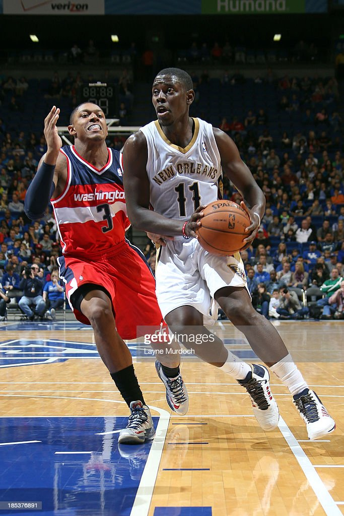 <a gi-track='captionPersonalityLinkClicked' href=/galleries/search?phrase=Jrue+Holiday&family=editorial&specificpeople=5042484 ng-click='$event.stopPropagation()'>Jrue Holiday</a> #11 of the New Orleans Pelicans drives past <a gi-track='captionPersonalityLinkClicked' href=/galleries/search?phrase=Bradley+Beal&family=editorial&specificpeople=7640439 ng-click='$event.stopPropagation()'>Bradley Beal</a> #3 of the Washington Wizards during an NBA game on October 19, 2013 at Rupp Arena in Lexington, Kentucky.