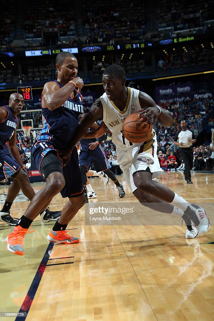 <a gi-track='captionPersonalityLinkClicked' href=/galleries/search?phrase=Jrue+Holiday&family=editorial&specificpeople=5042484 ng-click='$event.stopPropagation()'>Jrue Holiday</a> #11 of the New Orleans Pelicans drives to the basket against <a gi-track='captionPersonalityLinkClicked' href=/galleries/search?phrase=Ramon+Sessions&family=editorial&specificpeople=805440 ng-click='$event.stopPropagation()'>Ramon Sessions</a> #7 of the Charlotte Bobcats on November 2, 2013 at the New Orleans Arena in New Orleans, Louisiana.