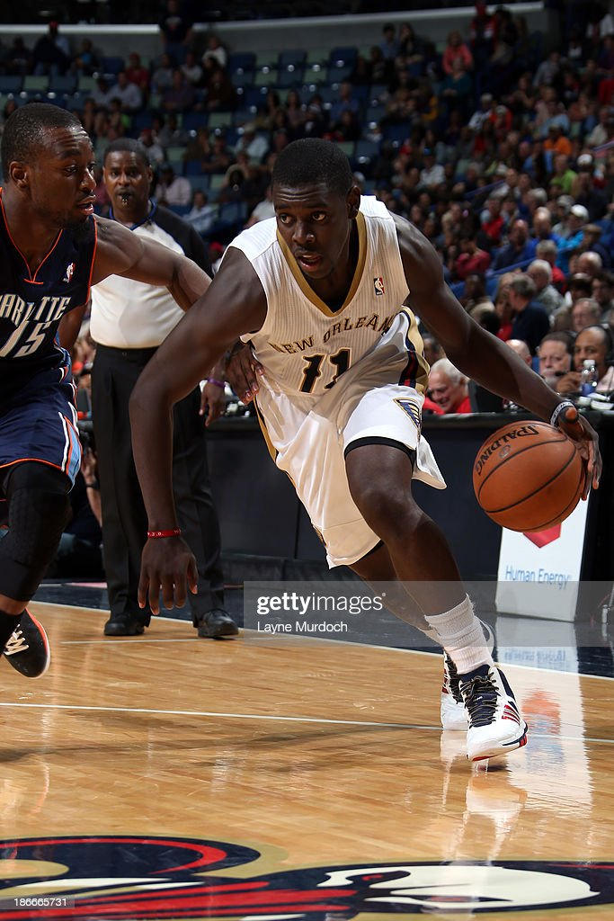 <a gi-track='captionPersonalityLinkClicked' href=/galleries/search?phrase=Jrue+Holiday&family=editorial&specificpeople=5042484 ng-click='$event.stopPropagation()'>Jrue Holiday</a> #11 of the New Orleans Pelicans drives to the basket against <a gi-track='captionPersonalityLinkClicked' href=/galleries/search?phrase=Kemba+Walker&family=editorial&specificpeople=5042442 ng-click='$event.stopPropagation()'>Kemba Walker</a> #15 of the Charlotte Bobcats on November 2, 2013 at the New Orleans Arena in New Orleans, Louisiana.