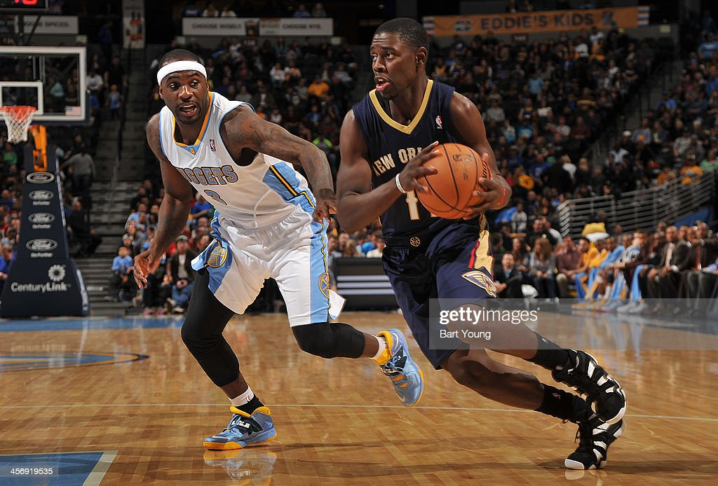 <a gi-track='captionPersonalityLinkClicked' href=/galleries/search?phrase=Jrue+Holiday&family=editorial&specificpeople=5042484 ng-click='$event.stopPropagation()'>Jrue Holiday</a> #11 of the New Orleans Pelicans drives to the basket against the Denver Nuggets on December 15, 2013 at the Pepsi Center in Denver, Colorado.