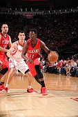 Jrue Holiday of the New Orleans Pelicans drives to the basket against the Houston Rockets on April 12 2015 at the Toyota Center in Houston Texas NOTE...