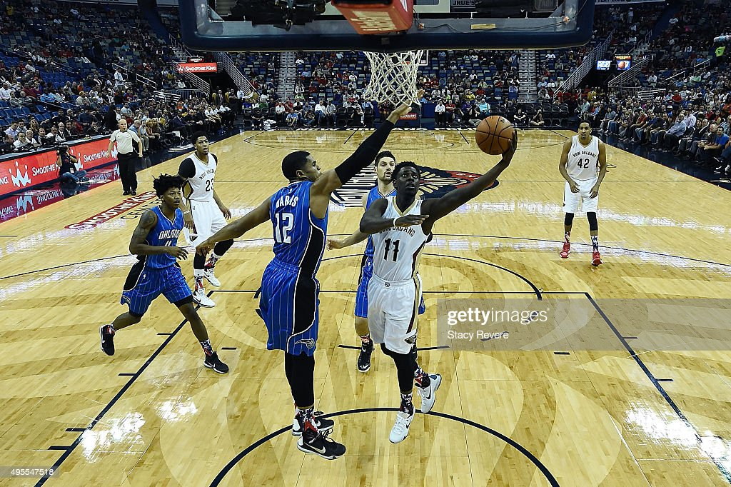 Jrue Holiday #11 of the New Orleans Pelicans drives to the basket against Tobias Harris #12 of the Orlando Magic during the first half of a game at the Smoothie King Center on November 3, 2015 in New Orleans, Louisiana.