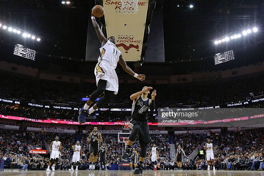 Jrue Holiday #11 of the New Orleans Pelicans dunks past Danny Green #14 of the San Antonio Spurs during the second half of a game at the Smoothie King Center on January 27, 2017 in New Orleans, Louisiana.