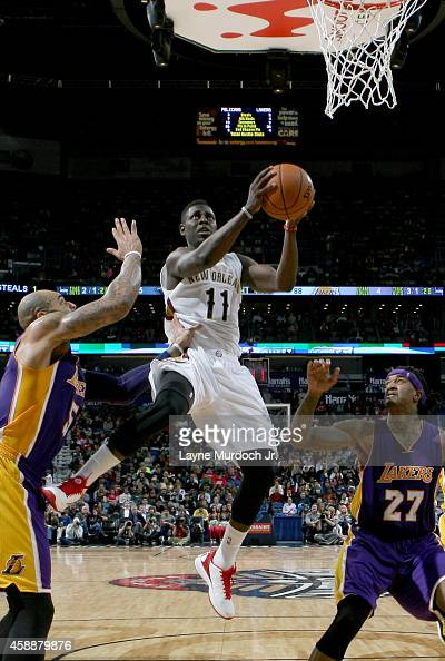 Jrue Holiday of the New Orleans Pelicans goes to the basket against the Los Angeles Lakers on November 12 2014 at the Smoothie King Center in New...