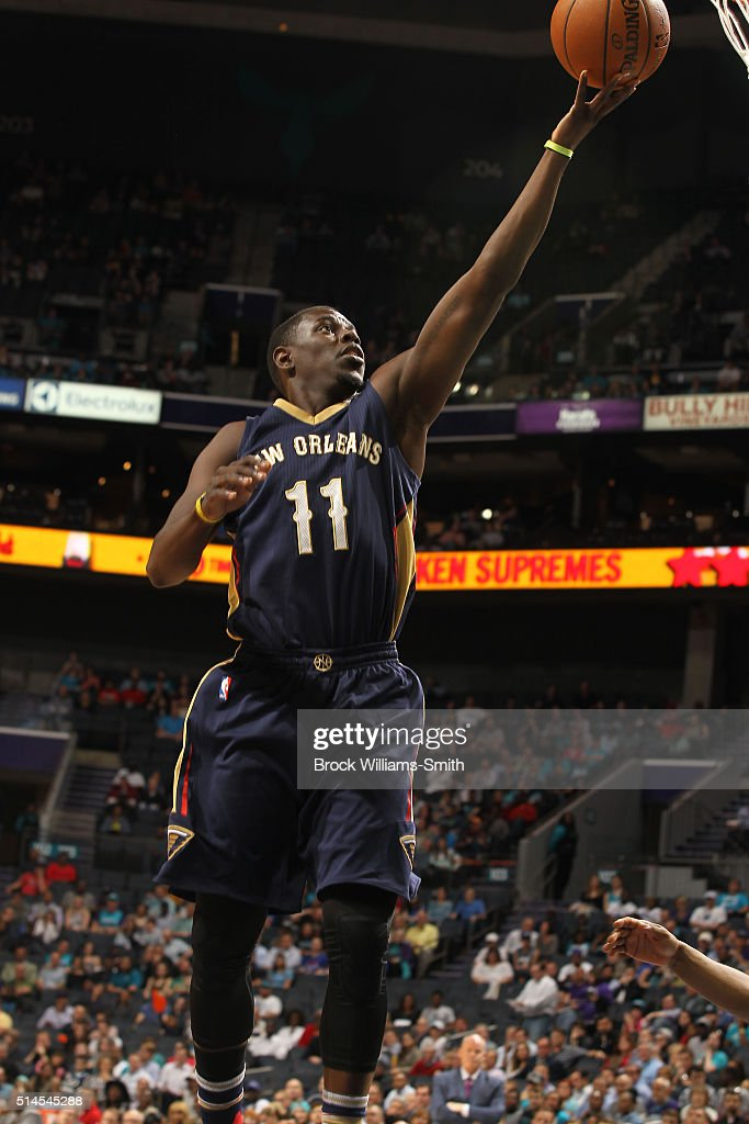 Jrue Holiday of the New Orleans Pelicans goes to the basket against the Charlotte Hornets during the game at the Time Warner Cable Arena on March 09...