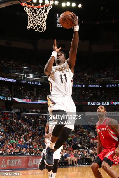 Jrue Holiday of the New Orleans Pelicans goes up for a lay up during a game against the Houston Rockets on March 17 2017 at Smoothie King Center in...