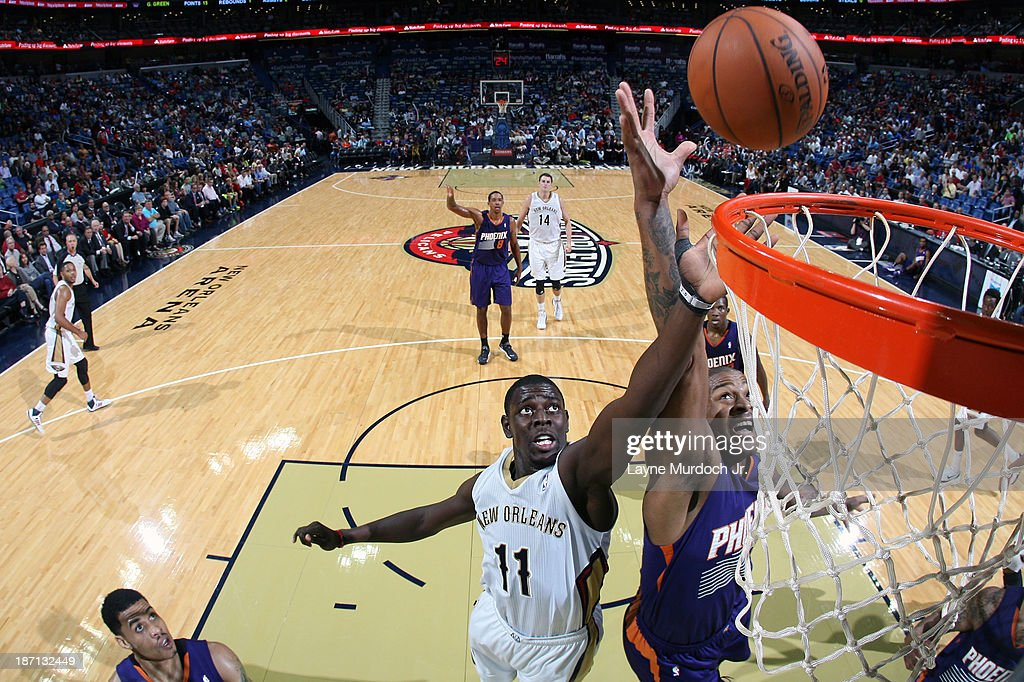 <a gi-track='captionPersonalityLinkClicked' href=/galleries/search?phrase=Jrue+Holiday&family=editorial&specificpeople=5042484 ng-click='$event.stopPropagation()'>Jrue Holiday</a> #11 of the New Orleans Pelicans goes up for a rebound against the Phoenix Suns on November 5, 2013 at the New Orleans Arena in New Orleans, Louisiana.