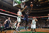 Jrue Holiday of the New Orleans Pelicans goes up for a shot against the Boston Celtics on January 12 2015 at the TD Garden in Boston Massachusetts...