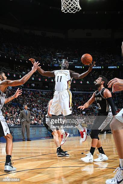 Jrue Holiday of the New Orleans Pelicans grabs a rebound against the San Antonio Spurs on December 26 2014 at Smoothie King Center in New Orleans...