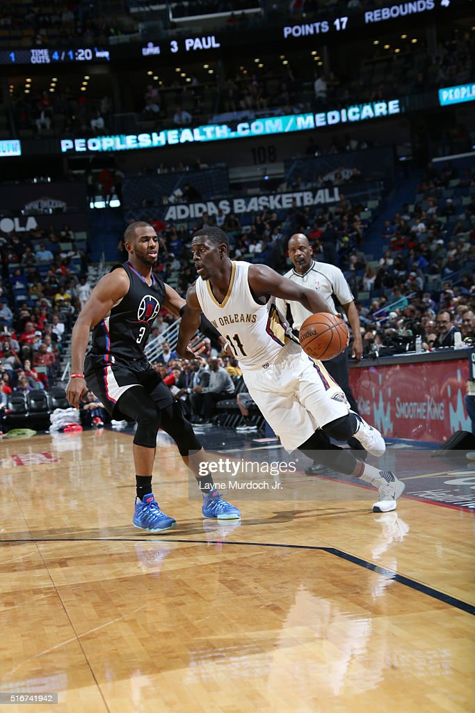 Jrue Holiday of the New Orleans Pelicans handles the ball against Chris Paul of the Los Angeles Clippers n March 20 2016 at Smoothie King Center in...