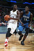 Jrue Holiday of the New Orleans Pelicans handles the ball against the Minnesota Timberwolves on November 14 2014 at the Smoothie King Center in New...