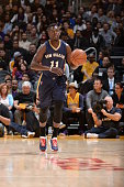 Jrue Holiday of the New Orleans Pelicans handles the ball against the Los Angeles Lakers during the game on December 7 2014 at STAPLES Center in Los...