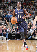 Jrue Holiday of the New Orleans Pelicans handles the ball against the Dallas Mavericks on December 10 2014 at the American Airlines Center in Dallas...