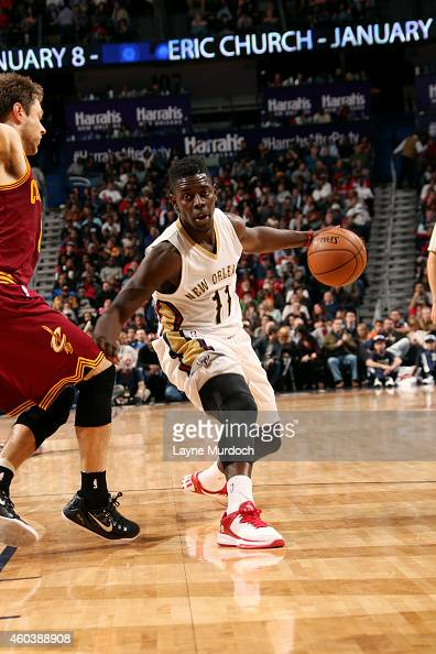 Jrue Holiday of the New Orleans Pelicans handles the ball against the Cleveland Cavaliers on December 12 2014 at the Smoothie King Center in New...