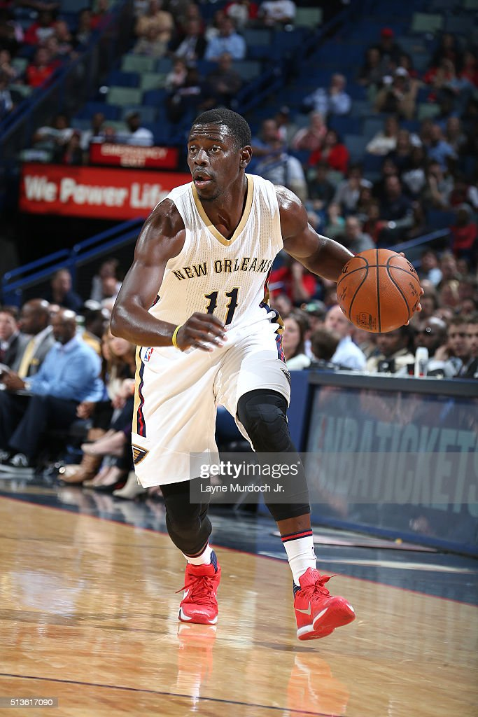 Jrue Holiday of the New Orleans Pelicans handles the ball during the game against the San Antonio Spurs on March 3 2016 at the Smoothie King Center...