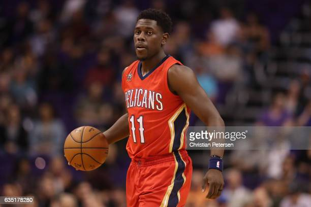 Jrue Holiday of the New Orleans Pelicans handles the ball during the first half of the NBA game against the Phoenix Suns at Talking Stick Resort...