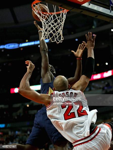 Jrue Holiday of the New Orleans Pelicans hits the gamewinning shot in triple overtime after being fouled by Taj Gibson of the Chicago Bulls at the...