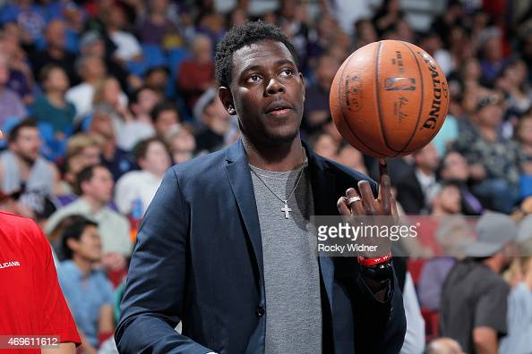 Jrue Holiday of the New Orleans Pelicans inactive against the Sacramento Kings on April 3 2015 at Sleep Train Arena in Sacramento California NOTE TO...