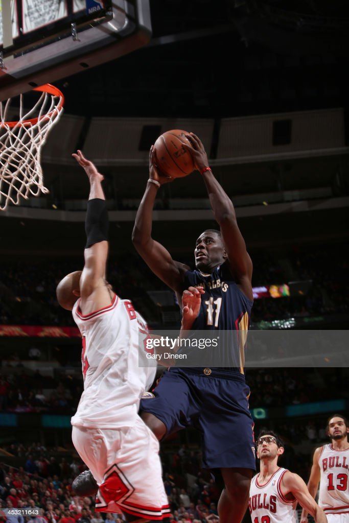 <a gi-track='captionPersonalityLinkClicked' href=/galleries/search?phrase=Jrue+Holiday&family=editorial&specificpeople=5042484 ng-click='$event.stopPropagation()'>Jrue Holiday</a> #11 of the New Orleans Pelicans is fouled by <a gi-track='captionPersonalityLinkClicked' href=/galleries/search?phrase=Joakim+Noah&family=editorial&specificpeople=699038 ng-click='$event.stopPropagation()'>Joakim Noah</a> #1 of the Chicago Bulls while going to the basket in the closing seconds of the third overtime period on December 2, 2013 at the United Center in Chicago, Illinois. Holiday subsequently made the free throw that sealed the victory for the Pelicans.