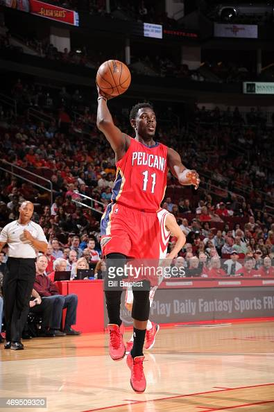 Jrue Holiday of the New Orleans Pelicans looks to pass against the Houston Rockets on April 12 2015 at the Toyota Center in Houston Texas NOTE TO...