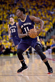 Jrue Holiday of the New Orleans Pelicans looks to pass the ball against the Golden State Warriors in the third quarter during the first round of the...