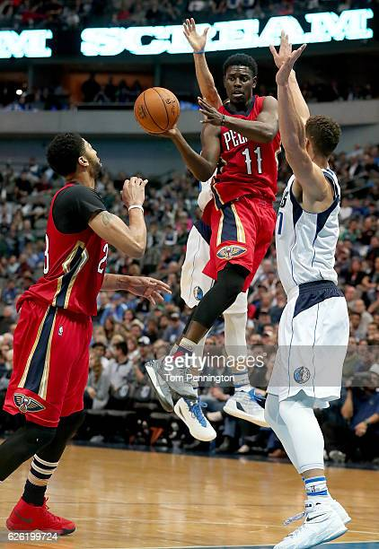 Jrue Holiday of the New Orleans Pelicans passes the ball to Anthony Davis of the New Orleans Pelicans against the Dallas Mavericks in the second half...