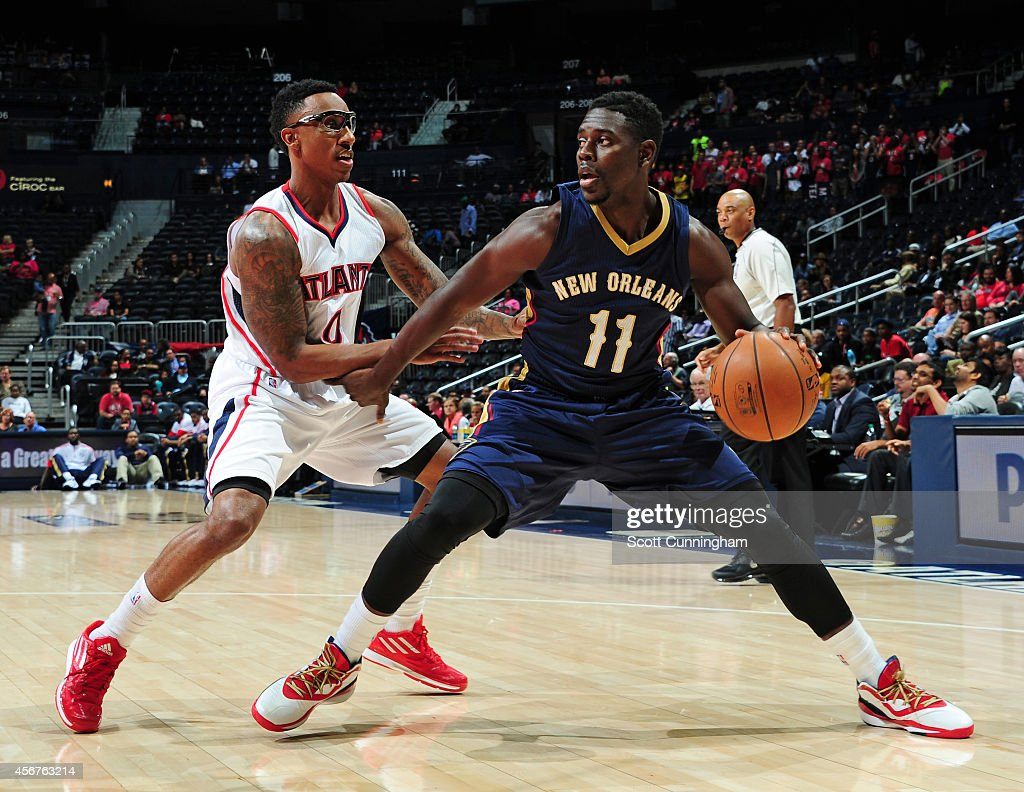 Jrue Holiday of the New Orleans Pelicans plays against Jeff Teague of the Atlanta Hawks on October 6 2014 at Philips Arena in Atlanta Georgia NOTE TO...