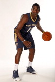 Jrue Holiday of the New Orleans Pelicans poses with the team's new road uniform on August 1 2013 at the New Orleans Pelicans practice facility in...
