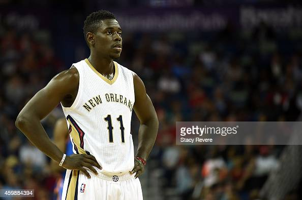 Jrue Holiday of the New Orleans Pelicans prepares to shoot a free throw during a game against the Oklahoma City Thunder at the Smoothie King Center...