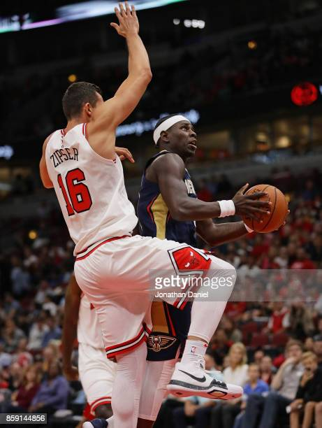 Jrue Holiday of the New Orleans Pelicans puts up a shot against Paul Zipser of the Chicago Bulls during a preseason game at the United Center on...