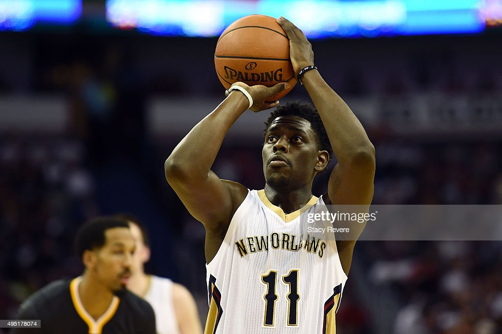 Jrue Holiday of the New Orleans Pelicans shoots a free throw during the first half of a game against the Golden State Warriors at the Smoothie King...