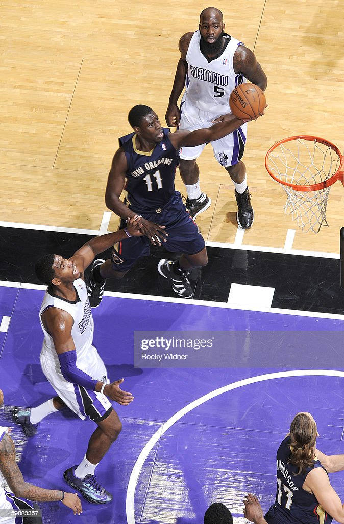 <a gi-track='captionPersonalityLinkClicked' href=/galleries/search?phrase=Jrue+Holiday&family=editorial&specificpeople=5042484 ng-click='$event.stopPropagation()'>Jrue Holiday</a> #11 of the New Orleans Pelicans shoots a layup against Jason Thompson #34 of the Sacramento Kings on December 23, 2013 at Sleep Train Arena in Sacramento, California.