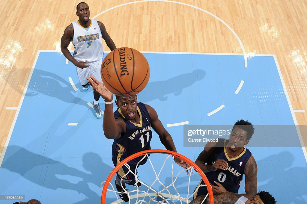 <a gi-track='captionPersonalityLinkClicked' href=/galleries/search?phrase=Jrue+Holiday&family=editorial&specificpeople=5042484 ng-click='$event.stopPropagation()'>Jrue Holiday</a> #11 of the New Orleans Pelicans shoots against the Denver Nuggets on December 15, 2013 at the Pepsi Center in Denver, Colorado.