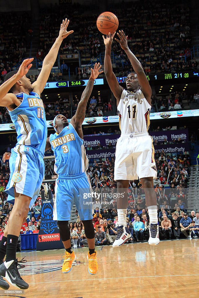 <a gi-track='captionPersonalityLinkClicked' href=/galleries/search?phrase=Jrue+Holiday&family=editorial&specificpeople=5042484 ng-click='$event.stopPropagation()'>Jrue Holiday</a> #11 of the New Orleans Pelicans shoots against the Denver Nuggets on December 27, 2013 at the New Orleans Arena in New Orleans, Louisiana.