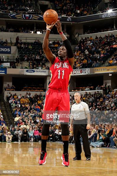 Jrue Holiday of the New Orleans Pelicans shoots against the Indiana Pacers on December 23 2014 at Bankers Life Fieldhouse in Indianapolis Indiana...